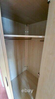 Corner located fitted wardrobes