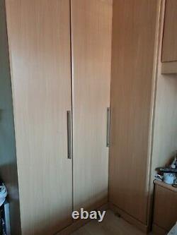 Fitted Oak Triple Wardrobe With Corner Unit