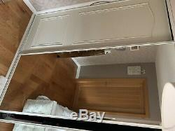 Floor to ceiling sliding fitted wardrobe including 2x mirrored doors